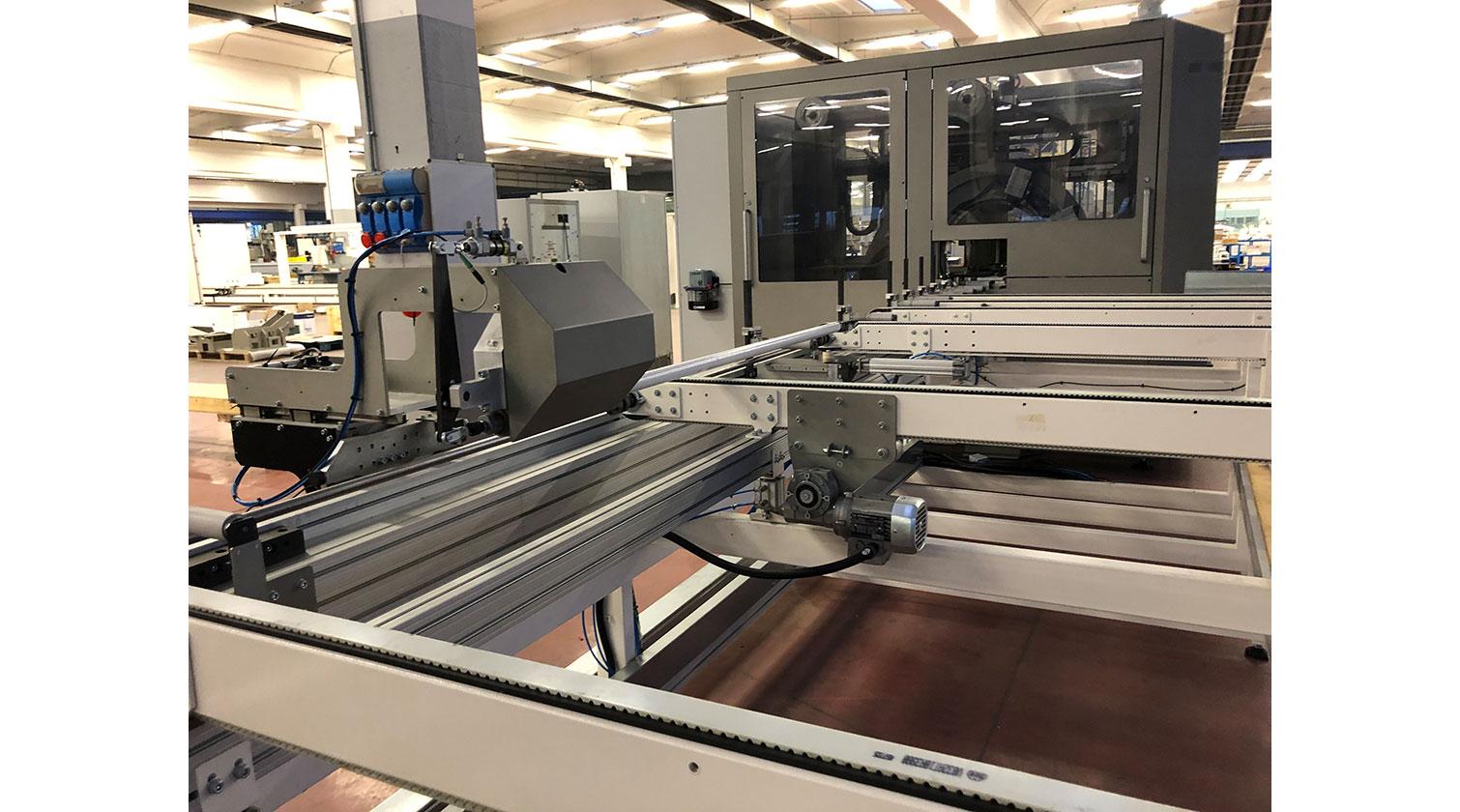 INT aluminum CNC Mecal MC 316 fabrication centre feeder 1