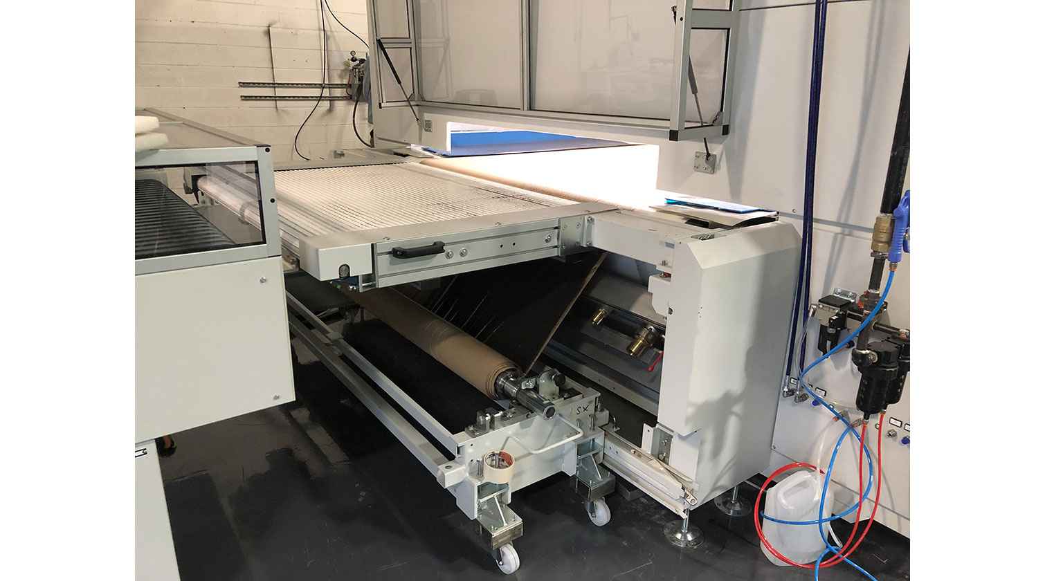 INT slab doors paint line Giardina Dualtech 415 paper roller rewind cart
